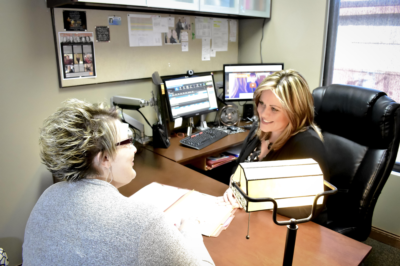 Casey at her desk